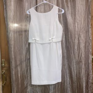 White dress with bow details